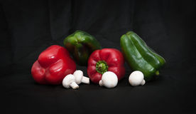 Mixed peppers and mushrooms Stock Photography