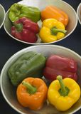 Mixed Peppers in Steel Bowls Stock Photo