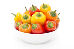 Mixed peppers in white plate Royalty Free Stock Photography