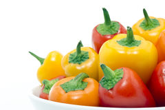 Mixed peppers in white plate Stock Image