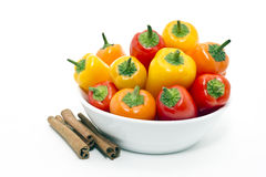 Mixed peppers in white plate Stock Photos