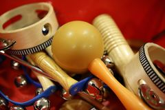 Mixed percussion toy instruments on red Stock Image