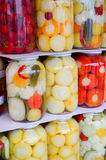 Mixed pickled vegetables in glass jar Stock Image