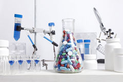 Mixed Pills in Science Beaker Stock Image