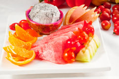 Mixed plate of fresh sliced fruits Royalty Free Stock Photography