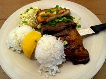 Mixed Plate Hawaiian Beef Chicken Rice Macaroni Entree. Traditional Hawaiian island mixed plate entree of BBQ Kalbi, Boneless Chicken breast plus two scoops rice Royalty Free Stock Photography
