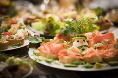 Mixed antipasti/appetizers served as starter at christmas and new years eve. Mixed plates of antipasti, appetizers, sandwiches and mediterranean specialties Stock Images