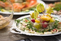 Mixed antipasti/appetizers served as starter at christmas and new years eve. Mixed plates of antipasti, appetizers, sandwiches and mediterranean specialties Royalty Free Stock Image