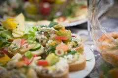 Mixed antipasti/appetizers served as starter at christmas and new years eve. Mixed plates of antipasti, sandwiches and mediterranean specialties served as Royalty Free Stock Images