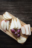 Mixed portuguese cheese tapas snack platter with apple and grape Royalty Free Stock Photography