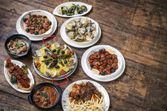 Mixed portuguese traditional rustic tapas food selection on wood royalty free stock images