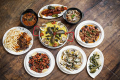 Mixed portuguese traditional rustic tapas food selection on wood Royalty Free Stock Image