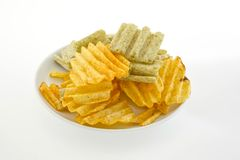 Mixed potato crisps and corn flake cereal on white background Royalty Free Stock Images