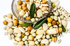 Mixed pulses with some Indian and asian popular lentlis. Raw dried organic fresh mixed pulses or mixed grains in a glass bowl on white Royalty Free Stock Images