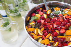 Mixed punch with fruits in metal bowl Stock Photo