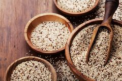 Mixed quinoa in bowl on wooden kitchen table. Healthy and diet superfood product.  royalty free stock image