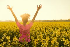 Female Woman Athlete Runner Celebrating In Yellow Flowers Royalty Free Stock Photos