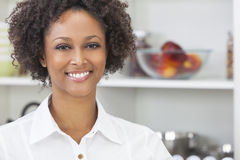 Mixed Race African American Girl in Kitchen Stock Image