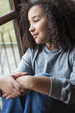 Mixed Race African American Girl Looking Out of Window Stock Images