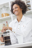 Mixed Race African American Girl Making Coffee Stock Photo