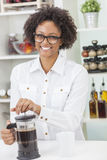 Mixed Race African American Girl Making Coffee Royalty Free Stock Images