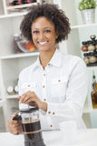 Mixed Race African American Girl Making Coffee Royalty Free Stock Image