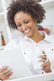 Mixed Race African American Girl Tablet Computer and Coffee Stock Photos