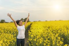 Mixed Race African American Girl Teenager Celebrating In Yellow Stock Photo