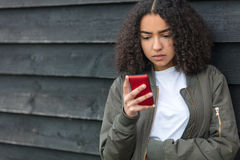 Mixed Race African American Girl Teenager on Cell Phone Stock Images