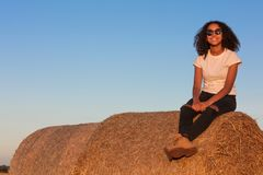 Mixed Race African American Girl Teenager Sitting on Hay Bale Stock Photos