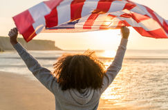 Mixed Race African American Girl Teenager With US Flag on Beach stock photography