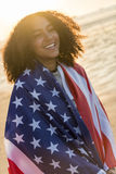 Mixed Race African American Girl Teenager Wrapped in USA Flag Royalty Free Stock Photo