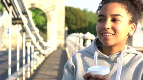 Mixed race African American girl teenager young woman drinking coffee stock footage