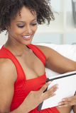 Mixed Race African American Girl Using Tablet Computer Stock Photo