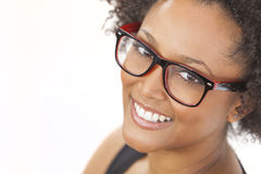 Mixed Race African American Girl Wearing Glasses. A beautiful intelligent mixed race African American girl or young woman looking happy and wearing geek glasses Royalty Free Stock Image
