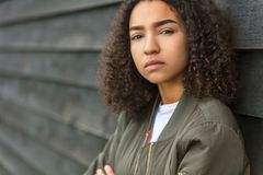 Mixed Race African American Teenager Woman Green Bomber Jacket stock photos