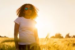 Mixed Race African American Woman Sunglasses Sunset. Beautiful happy mixed race African American female girl teenager young woman wearing relective aviator Stock Images