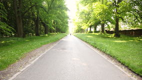 Mixed race African American young adult teenager girl running jogging on a tree lined country road stock video footage
