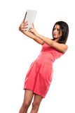 Mixed race african woman taking selfie self photo. Royalty Free Stock Photo