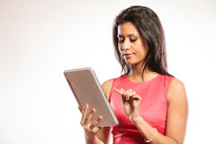 Mixed race african woman using pc tablet. Royalty Free Stock Photography