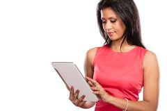 Mixed race african woman using pc tablet. Royalty Free Stock Image