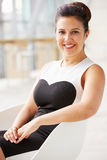 Mixed race Asian businesswoman relaxing, vertical portrait Stock Photo