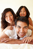 Mixed race Asian family Stock Images