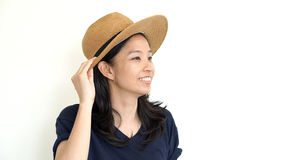 MIxed race asian girl wearing hat and smiling Stock Photo