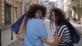 Mixed race and asian shopaholic women smiling stock video footage