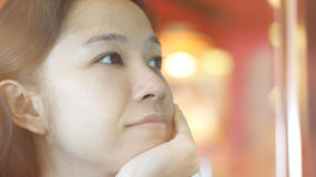 Mixed race Asian woman looking away, thinking and smiling Stock Photos
