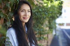 Mixed race Asian woman outdoors looking away, horizontal Stock Photos