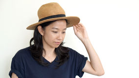 MIxed race asian woman wearing hat on white background Stock Image
