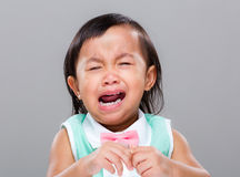 Mixed race baby cry. With gray background Royalty Free Stock Images