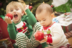 Mixed Race Baby and Young Boy Enjoying Christmas Morning  Royalty Free Stock Photo